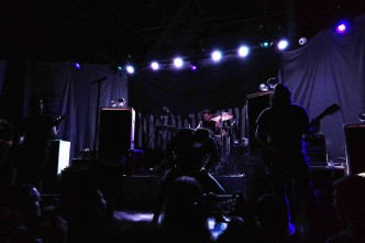 "Deafheaven's whirring black metal was a significant change from Inter Arma, but the crowd seemed to break out of its swaying trance as ""Brought to the Water"" opened the set."